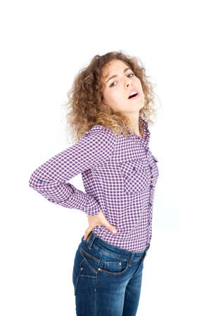 Beautiful Hispanic woman doing different expressions in different sets of clothes: backache photo