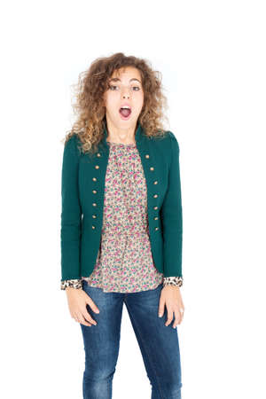 Beautiful Hispanic woman doing different expressions in different sets of clothes: surprise photo