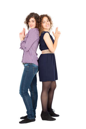 Beautiful Hispanic women doing different expressions in different sets of clothes: playing together photo