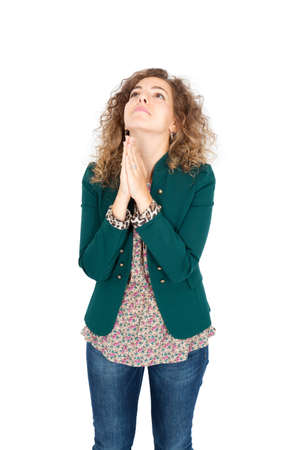 Beautiful Hispanic woman doing different expressions in different sets of clothes: praying Stock Photo