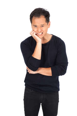 asian man face: Handsome man doing different expressions in different sets of clothes: toothache Stock Photo