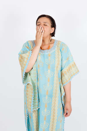 Beautiful woman doing different expressions in different sets of clothes: yawning photo