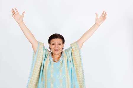 arms raised: Beautiful woman doing different expressions in different sets of clothes: arms raised Stock Photo