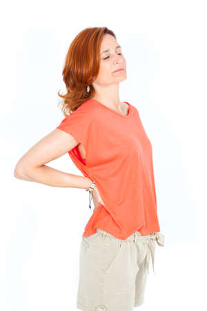 Beautiful businesswoman doing different expressions in different sets of clothes: backache photo