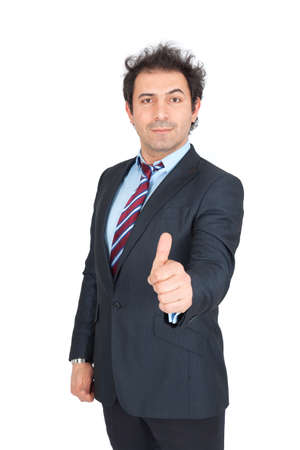 Handsome arabic man doing different expressions in different sets of clothes: thumbs up photo