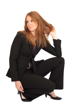 Beautiful businesswoman doing different expressions in different sets of clothes: posing Stock Photo