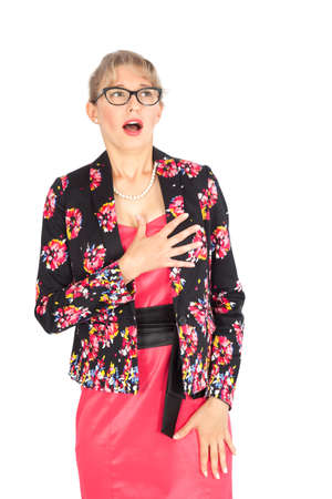 Beautiful businesswoman doing different expressions in different sets of clothes: heart attack photo