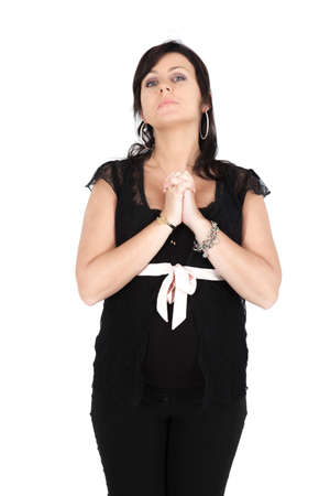 Beautiful woman doing different expressions in different sets of clothes: praying photo