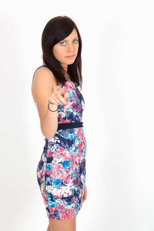 Beautiful woman doing different expressions in different sets of clothes: pointing photo