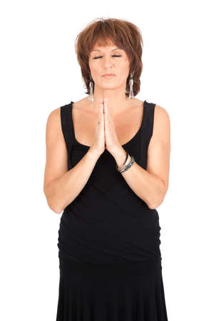 Beautiful woman doing different expressions in different sets of clothes: prayer photo