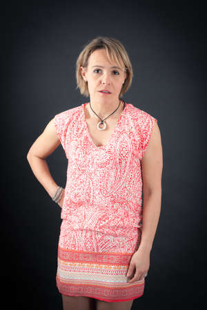 Beautiful woman doing different expressions in different sets of clothes: surprise Stock Photo