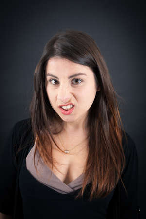 top hate: Beautiful woman doing different expressions in different sets of clothes: angry