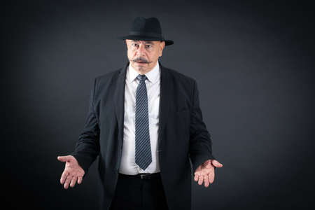 black head and moustache: Handsome man doing different expressions in different sets of clothes: surprise Stock Photo