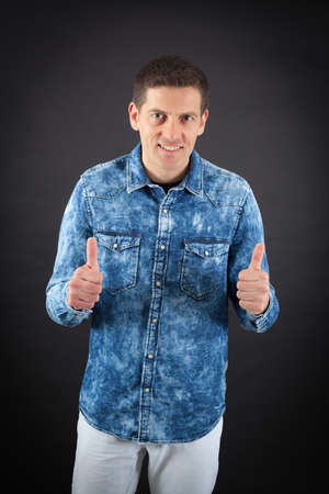 thumbsup: Handsome man doing different expressions in different sets of clothes: thumbsup Stock Photo
