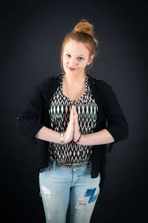 late teens: Beautiful woman doing different expressions in different sets of clothes: prayer