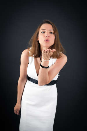 Beautiful woman doing different expressions in different sets of clothes: kiss Stock Photo