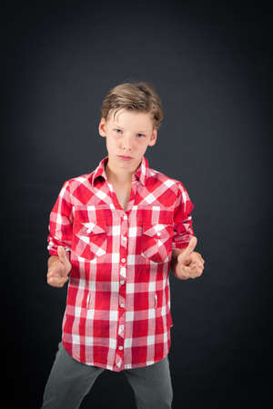 late teens: Handsome boy doing different expressions in different sets of clothes: gun sign Stock Photo