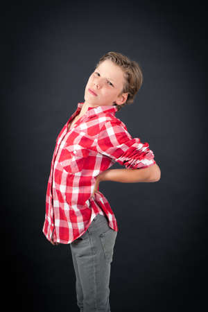 over black: Handsome boy doing different expressions in different sets of clothes: backache Stock Photo