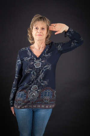 one armed: Beautiful woman doing different expressions in different sets of clothes: at attention