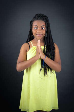 late teens: Beautiful girl doing different expressions in different sets of clothes: prayer Stock Photo