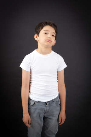 gape: Handsome boy doing different expressions in different sets of clothes: bored Stock Photo