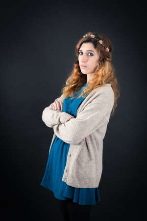 jewish ethnicity: Beautiful woman doing different expressions in different sets of clothes: arms crossed Stock Photo