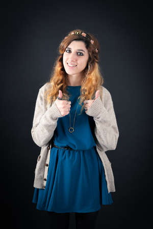 jewish ethnicity: Beautiful woman doing different expressions in different sets of clothes: thumbs up
