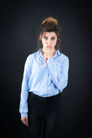 jewish ethnicity: Beautiful woman doing different expressions in different sets of clothes: be quiet Stock Photo