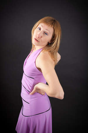 russian ethnicity: beautiful woman doing different expressions in different sets of clothes: backache Stock Photo