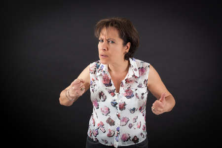 Beautiful woman doing different expressions in different sets of clothes: angry