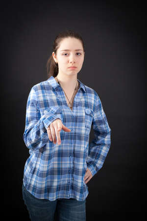 suspicion: beautiful woman doing different expressions in different sets of clothes: suspicion Stock Photo