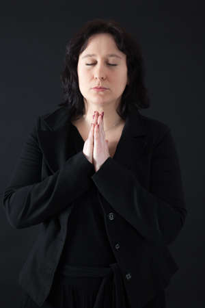 isolated background: Beautiful woman doing different expressions in different sets of clothes: prayer