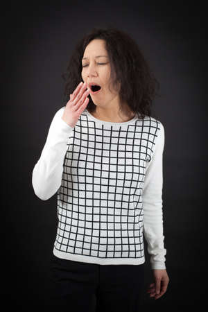 beautiful woman doing different expressions in different sets of clothes: yawn Stock Photo