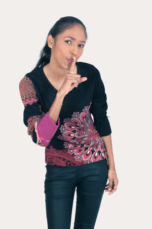 Beautiful woman doing different expressions in different sets of clothes: be quiet Stock Photo