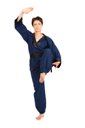Beautiful woman doing different expressions in different sets of clothes: fighting Stock Photo