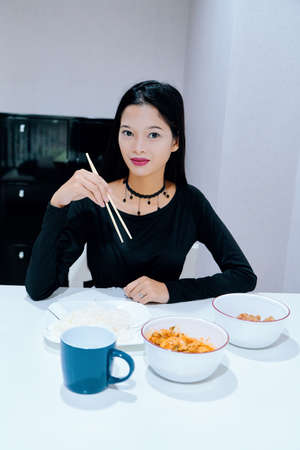 Beautiful woman posing - eating, sitting, smiling face Standard-Bild