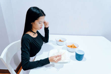 Beautiful woman posing - eating, sitting, sad, alone, thinking