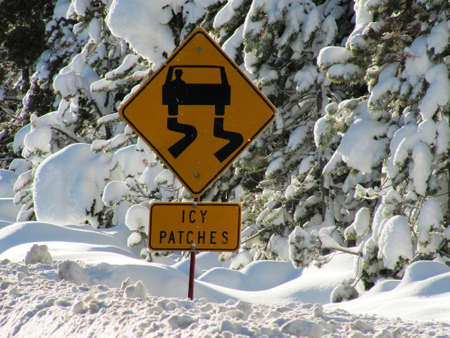 Caution Icy patches warning sign photo