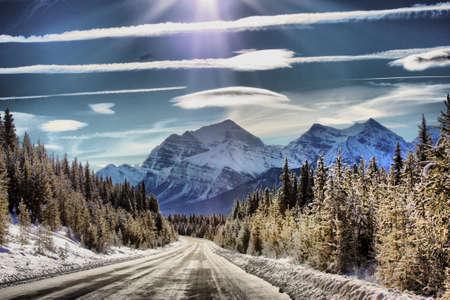 Icy road heading towards a Mountain photo