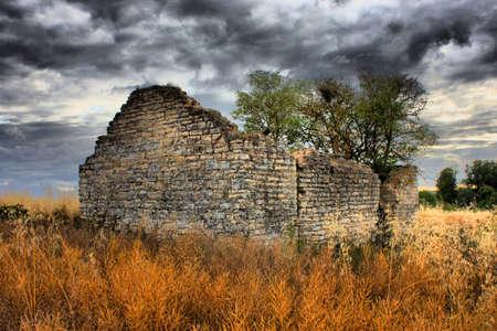 derelict: Derelict barn under a moody sky Stock Photo
