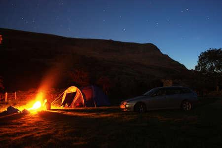 Campfire under a starry sky photo