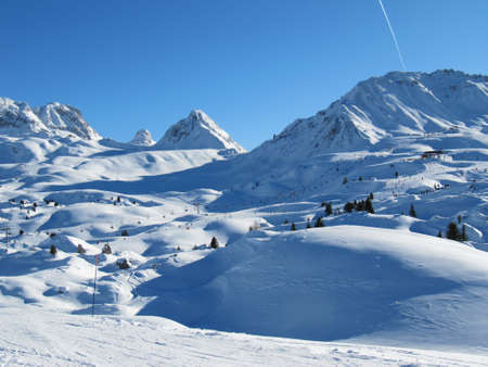 Alpine mountain range under a deep blue sky
