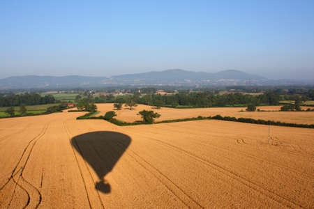 Hot air balloon shadow on the English countryside Stock Photo