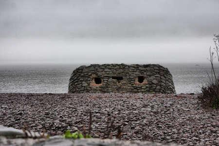 wartime: wartime gun emplacement on a shingle beach