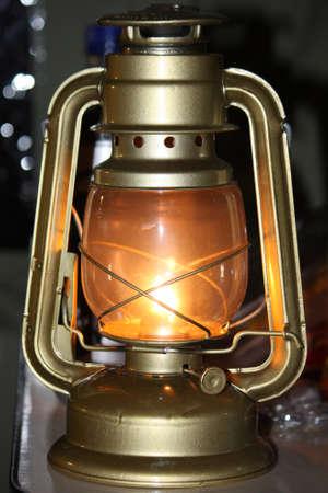 hurricane lamp: A glowing hurricane lamp Stock Photo