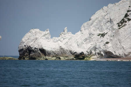 chalky: white chalky cliffs with blue sea and sky Stock Photo