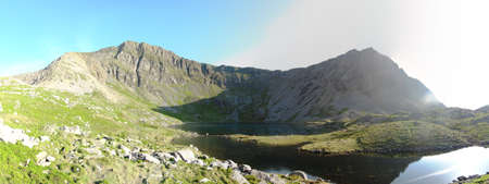 Panorama at Llyn-y-Gadair on cadair idris mountain in snowdonia Stock Photo