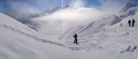 A skier on the piste in front of beautiful mountains Stock Photo