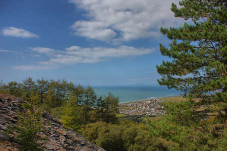 a view over sunny cardigan bay from the hills above Stock Photo