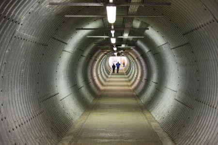 sheeted: long circular pedestiran tunnel sheeted in corrugated metal
